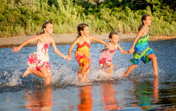 Four little girls having fun in the water in Ada bojana, Montene Royalty Free Stock Photos