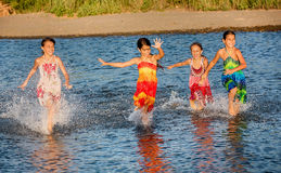 Four little girls having fun in the water on Ada bojana, Montene Royalty Free Stock Photography