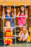 Four little girls playing on the playground. Four little girls are playing on the playground Royalty Free Stock Photo