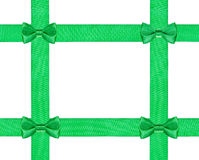 Four little green bow knots on four satin ribbon Stock Photo