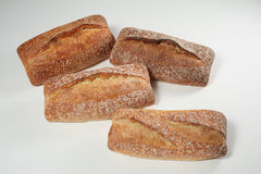 Four Loaves of Various Breads Stock Photography