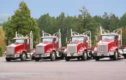 Four trucks in the maintenance yard. stock image