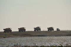 Four Lorries Moving Shingle in East Sussex UK Royalty Free Stock Photo
