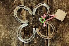 Four lucky horseshoes with a shamrock Royalty Free Stock Photography