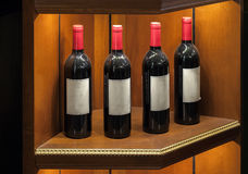 Four luxury red vine bottles on the shelf Stock Photos