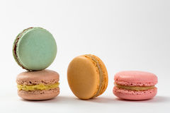Four macaroons sweet desserts. Isolated on white background. Colorful macarons on white table Stock Image