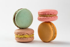 Four macaroons sweet desserts. Isolated on white background. Colorful macarons on white table Royalty Free Stock Photography