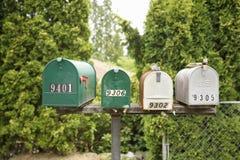 Four Mailboxes Royalty Free Stock Photos