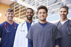 Four male healthcare colleagues standing outdoors, portrait stock images
