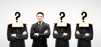 Four man with box on hand Royalty Free Stock Image