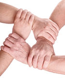 Four man hands holding each other Stock Images