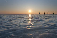 Four man walking on ice. Walking on ice of frozen sea Stock Photography