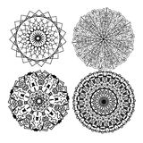 Four mandalas. In black and white. Vectors. Color as you wish Royalty Free Stock Image
