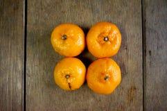 Four mandarin oranges Royalty Free Stock Photo
