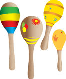 Four Maracas. Four toy maracas in many colors Royalty Free Stock Images