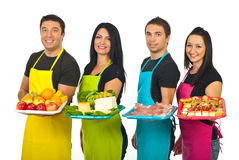 Four market workers with their products Stock Photo