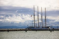 Four-masted frigate with deflated sails in the port of Lisbon Portugal Stock Photos
