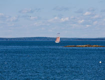 Four Masted Schooner in Blue Bay Royalty Free Stock Photography