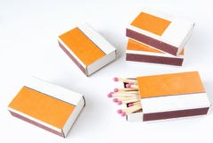 Four matchbox with matches over white Royalty Free Stock Photos