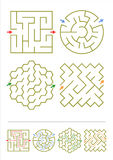 Four maze games with answers. Four simple mazes of various shapes. Answers included Royalty Free Stock Photo