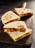 Four meat and veggie filled quesadillas stock photography