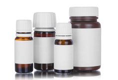 Four medicine bottles isolated stock photography