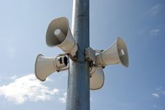 Four megaphone hanging on a pole Royalty Free Stock Images