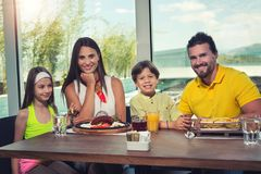 Family having great time in a restaurant Stock Image