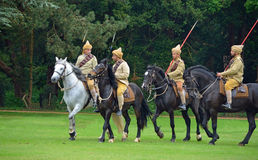 Four members of the Punjab Lancers in World War One uniform riding horses. Royalty Free Stock Photos