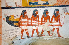 Four men carrying a mummy. Detail of the decoration of the tomb of Amenemonet, a priest in the Ramesside Period of Ancient Egypt. West Bank, Luxor royalty free stock photos