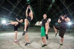 Four men practicing kick box Stock Photography