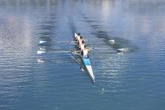 Four Men Rowing Stock Photos