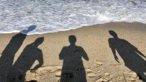 Free Four Men's Shadows On The Beach Stock Photos - 185543633
