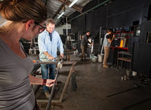 Workers Making Glass Objects stock image