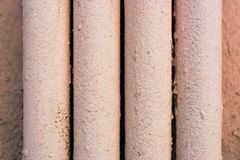Four metal pipes painted with pink paint Stock Image