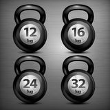 Four metallic kettle bells Royalty Free Stock Images