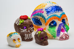 Four Mexican Calaverita de azucar Candy Skull and Calaverita de Chocolate, Royalty Free Stock Images