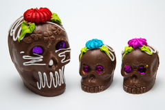 Four Mexican Calaverita de azucar Candy Skull and Calaverita de Chocolate, Royalty Free Stock Photos