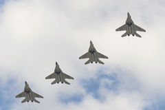 Four military aircraft MiG-29 flying over the Red Square Stock Photos