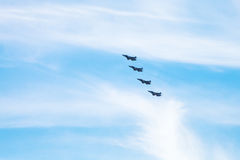 Four military fighter aircrafts in cloudy sky Stock Photo