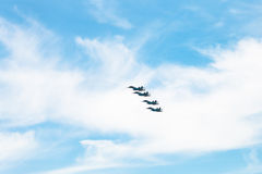 Four military fighter airplanes in white clouds Royalty Free Stock Image