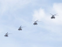 Four military helicopters Mi-35 flying Royalty Free Stock Photography