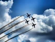 Four military training jet aircraft in aerobatic team. royalty free stock images