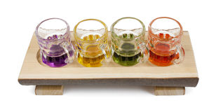 Four Mini Pitchers on a Wooden Tray Stock Photos
