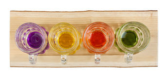 Four Mini Pitchers on a Wooden Tray Stock Images