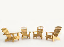 Four miniature adirondack chairs on white Royalty Free Stock Photo