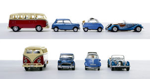 Four miniature cars Stock Photos