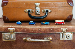 Four miniature model car. Four miniature model car toys on vintage suitcase Royalty Free Stock Images