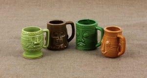 Four Miniature Mugs Stock Photos