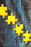 Four missing pieces. Close-up of a jigsaw puzzle Royalty Free Stock Image